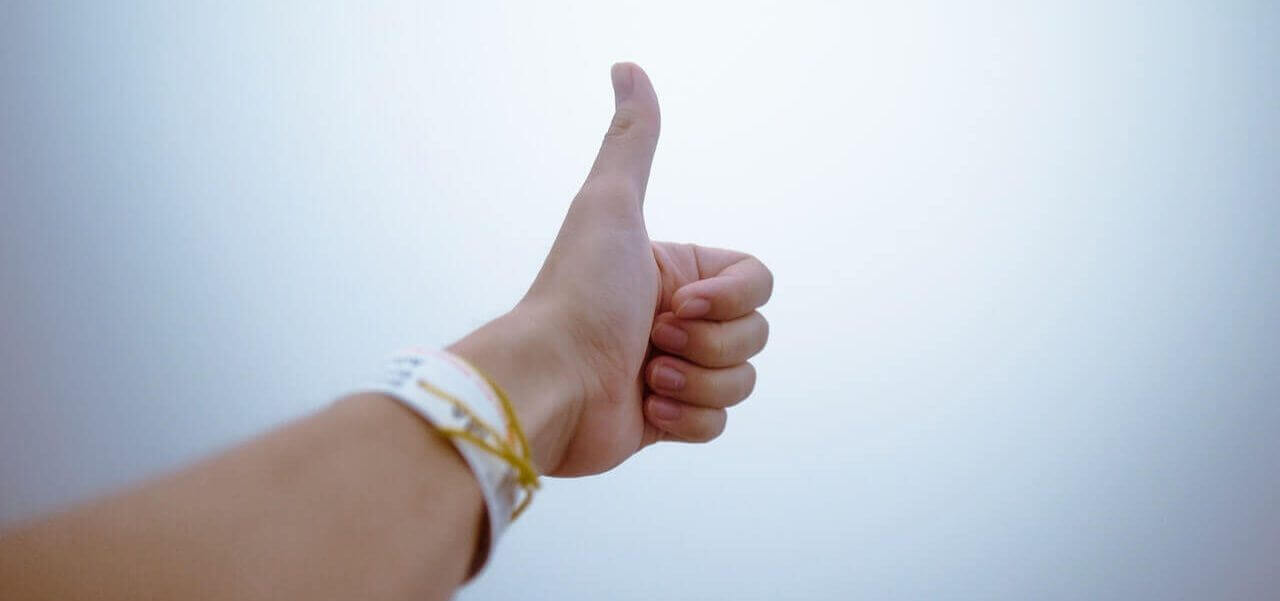 A person making a thumbs up.