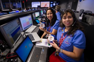 2 female NASA employees posing at their workstations for the Mars Curiosity program.