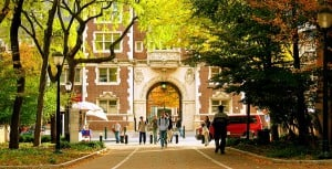 College students walking through entry gate at University of Pennsylvania.