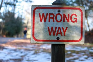 """Photograph of a """"Wrong Way"""" sign that symbolizes your mistakes as a high school student, which you need to explain during the college admissions process."""