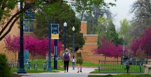 Students walking inside University of Northern Colorado college campus.