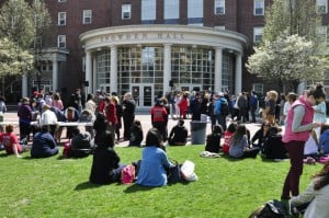 Students sit outside Snowden Hall at the Johnson and Wales University Providence campus.