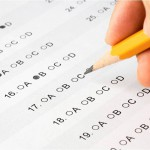 Student pencils in multiple choice answers on their ACT exam.