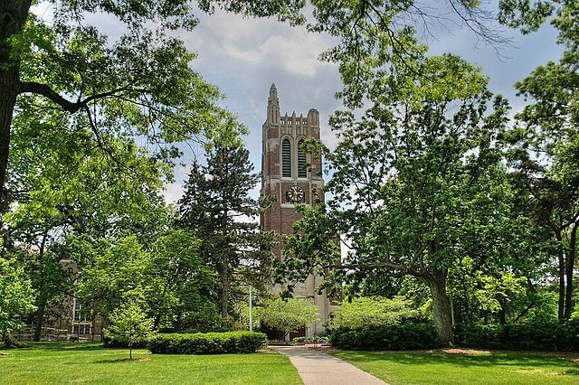 Beaumont Tower at Michigan State University seen behind the trees.