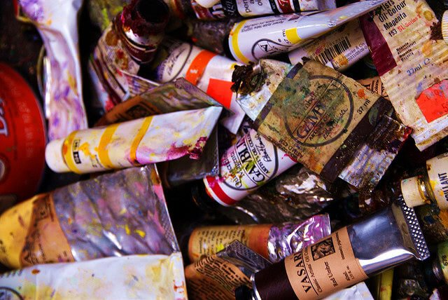 Dirty paint tubes and containers.