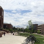 Students walking in University of Nevada, Reno campus with bicycle racks.