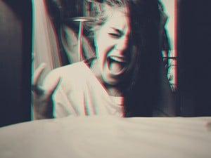 A woman screaming.