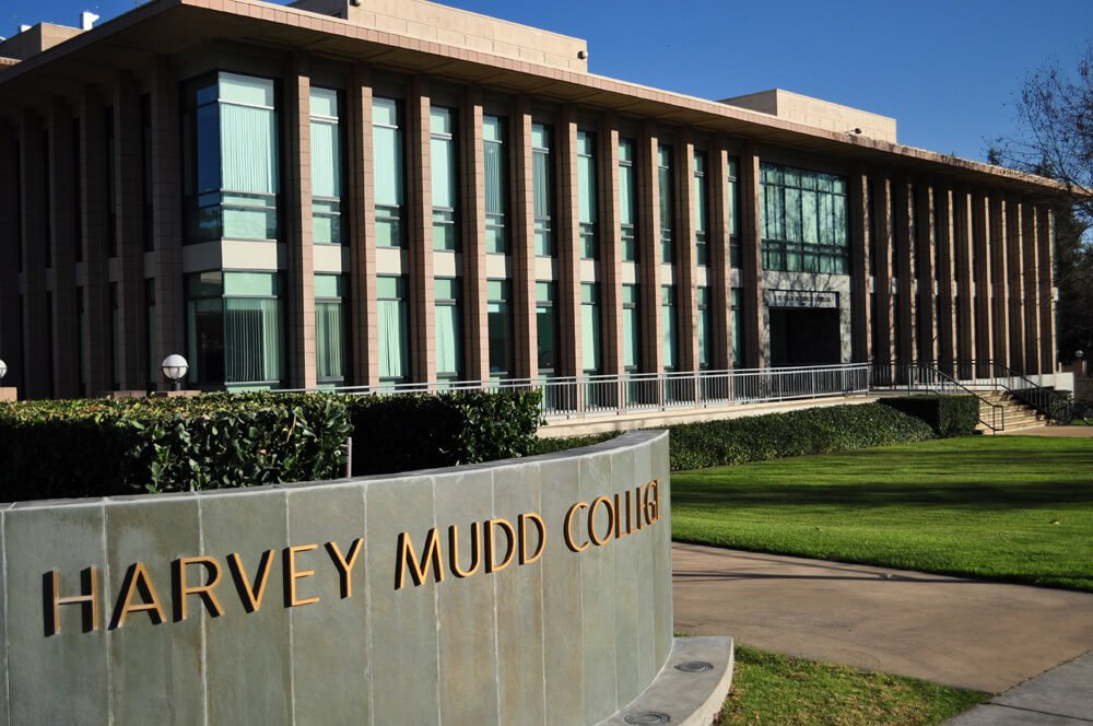 Harvey Mudd College entrance sign and building on a sunny day.