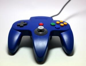 Close-up shot of a Blue Nintendo N64 Controller.