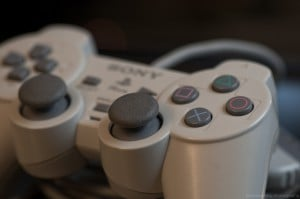 Close-up shot of a gray Sony Playstation game controller.