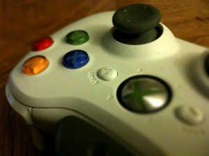 Close-up shot of a white Xbox game controller with red, green, blue and yellow buttons.