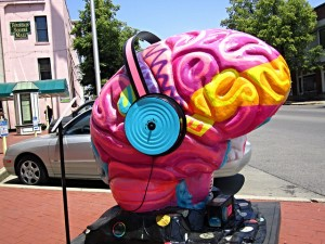 There are some soundtracks that are designed to have a positive affect on your brain. You can find them on Spotify