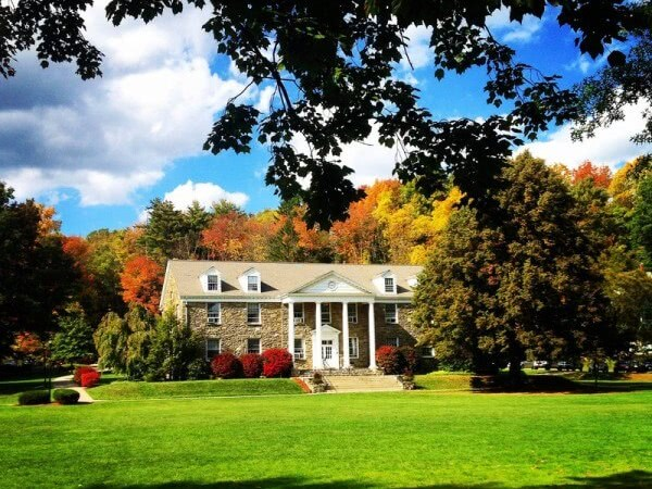 Houghton College campus surrounded by autumn trees.