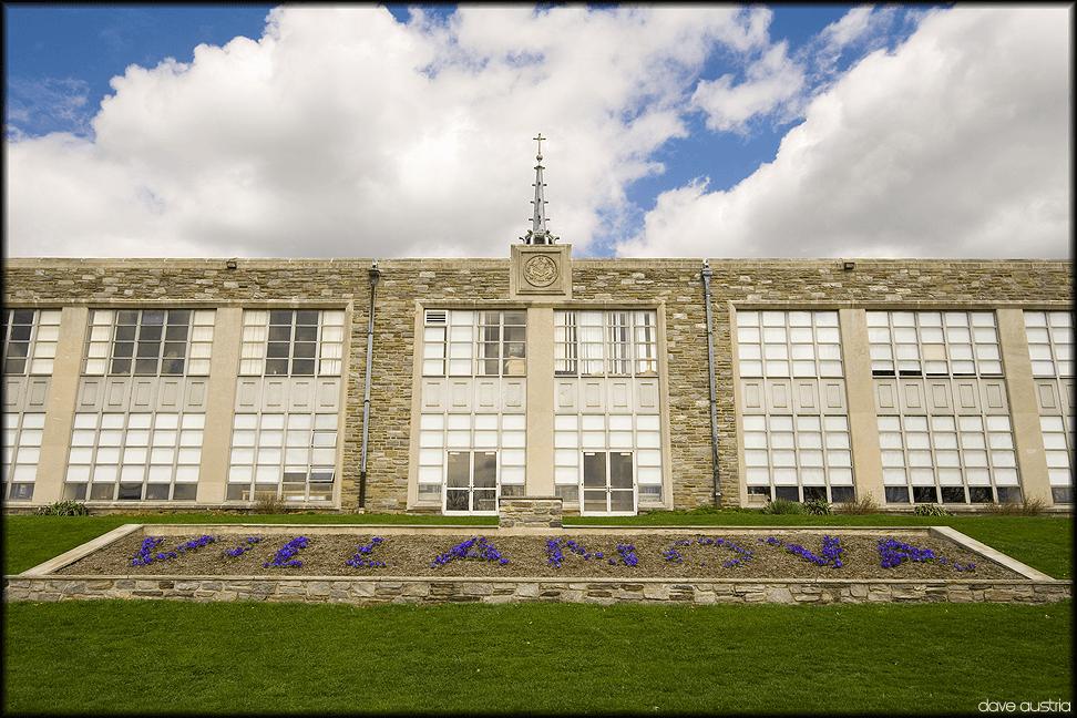 "Villanova University building with flowers in front spelling ""Villanova""."