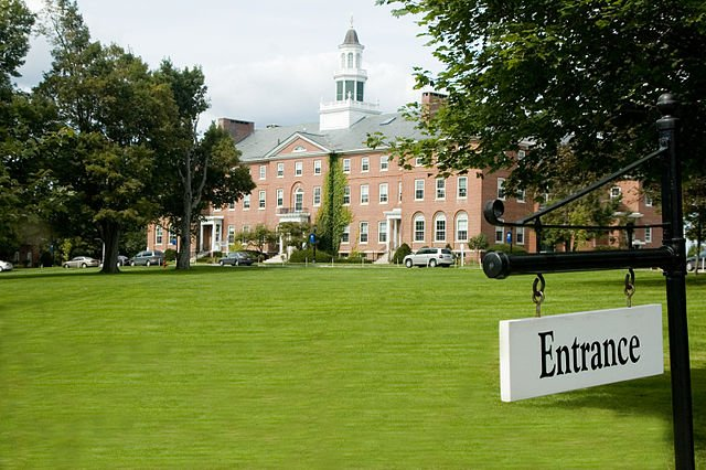 Colby-Sawyer College campus field and an entrance sign on the foreground.