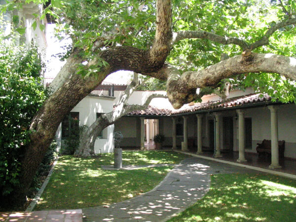 Tree-filled Balch Hall courtyard at Scripps College.