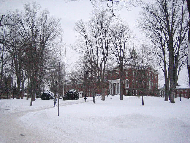 Students walking through a snow covered campus at Bates College.