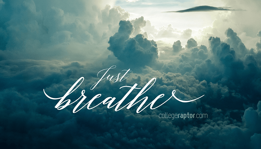 """A picture of clouds with text overlayed that says """"Just Breathe""""."""