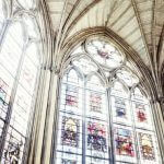 Stained glass windows with sunlight streaming through them.