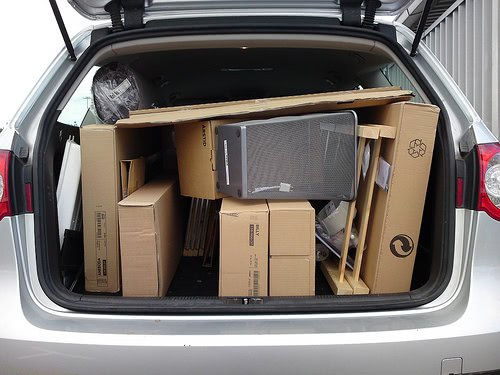 A van trunk filled to the brim with college moving boxes.