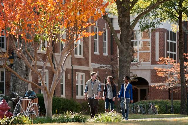 3 students walking through University of Central Arkansas campus.