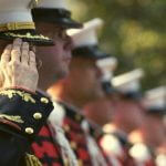 Military personnel saluting.
