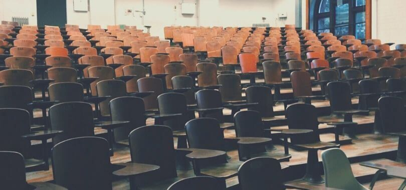 Rows of chairs in a lecture hall.