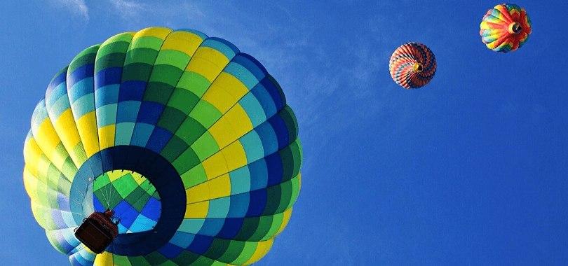 Three hot air balloons in the sky.
