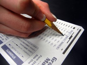 College student bubbling in an answer on a Scantron.