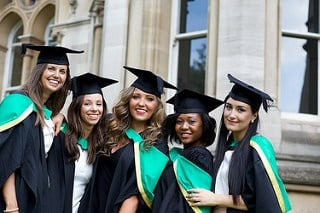 Five graduate female students posing for a picture taking.