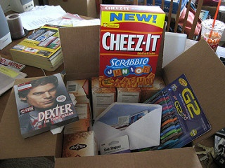 A box filled with school supplies and snacks.