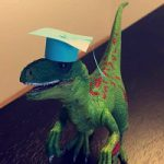 Roxie wearing a graduation cap