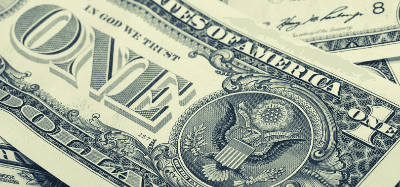 A close-up picture of a one dollar bill.