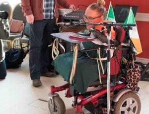 Joanne O'Riordan, a girl with no limbs, in a wheelchair giving a speech.