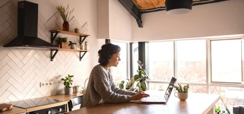 A student at home on their laptop.