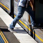 Student boarding a train.