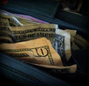 Wallet full of dollars.