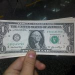 Hand holding dollars.