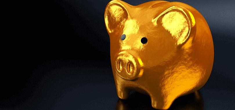 A golden piggy bank with a dark background.