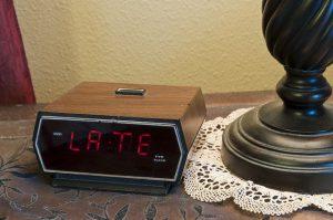 "Digital alarm clock showing ""late""."
