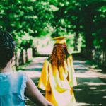 Parents walking behind their graduating student.
