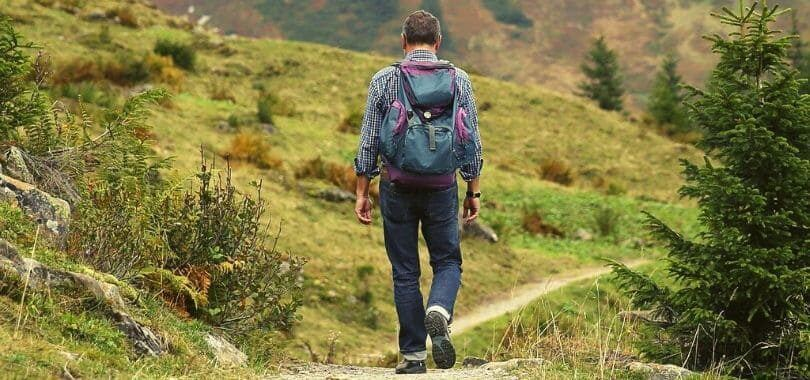 A student hiking in the hills during the summer.