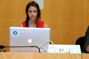 Serious female student using her laptop.