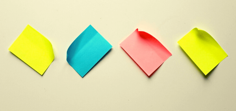 Four post-it notes stuck to a surface.