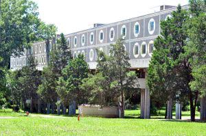 Tougaloo College campus building covered with green trees.