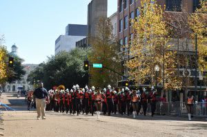 Jackson State University marching band parading on the street.