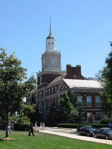Howard University campus building with students walking around.