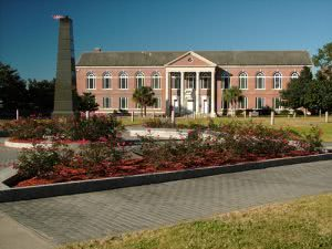 Florida Agricultural and Mechanical University campus building with a field of flowers.