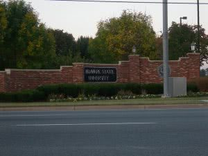 College sign at Delaware State University entrance taken from across the street.