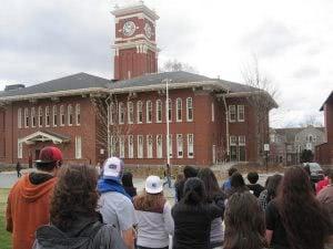 Washington State University students facing a school building.